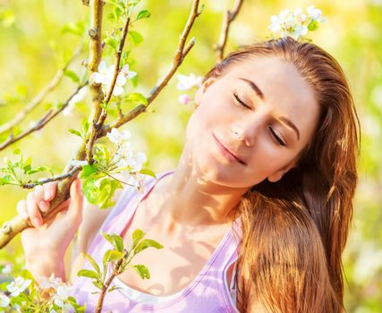 Cute girl with closed eyes outdoor