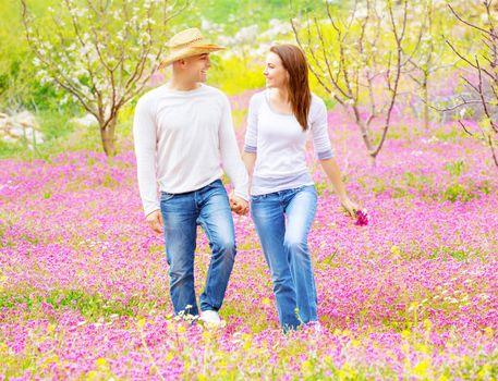 Happy lovers walking outdoors