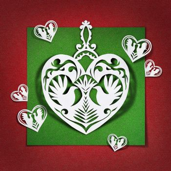 Heart with doves of white paper on red background