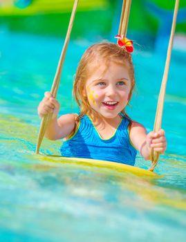 Cheerful girl in aqua-park