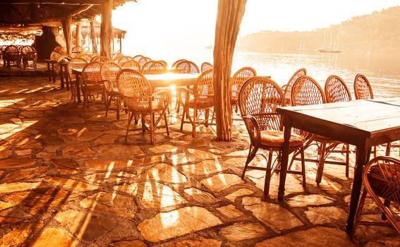 Seaside cafe in sunset light
