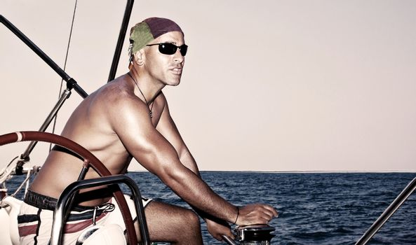 Handsome man on sail boat