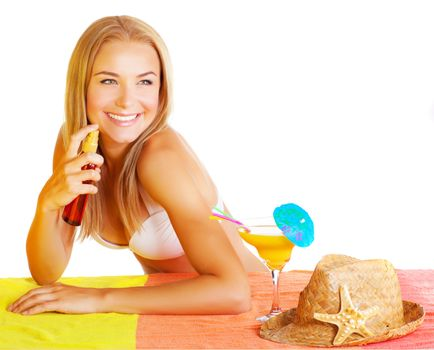 Sexy woman using sunscreen