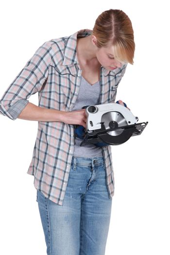 Woman confused by circular saw
