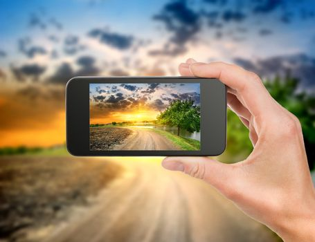 Phone and evening landscape