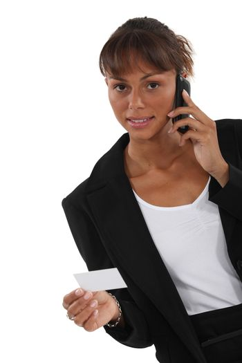 Woman calling number on business card