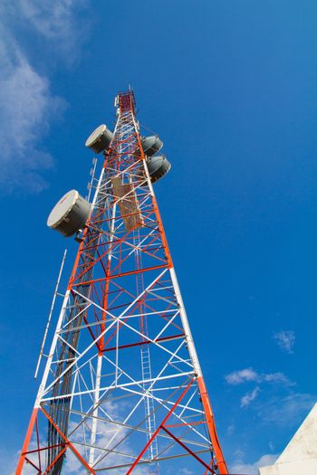 large communication tower with satelite dishes