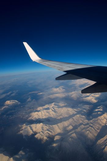 aircraft flying over snowed mountains of Pyrenees