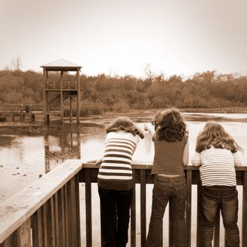 girls looking at park lake in Texas