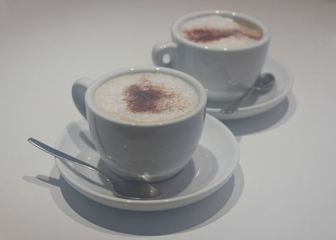 Two cups of capuccino