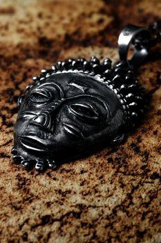 Photo of Voodoo Iron Mask on desert background