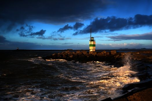 North sea waves and lighthouse in Ijmuiden, Holland