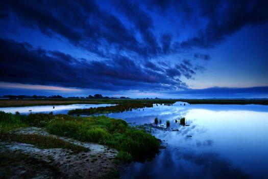 cloudscape at sunrise over swamp