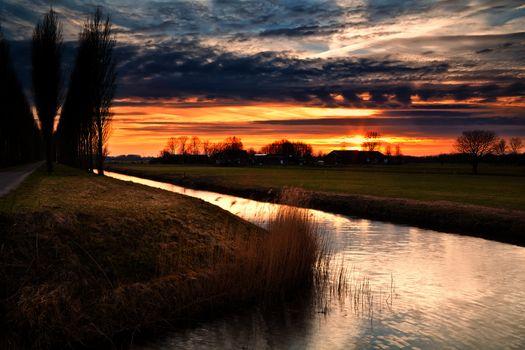 dramatic sunset in Dutch farmland