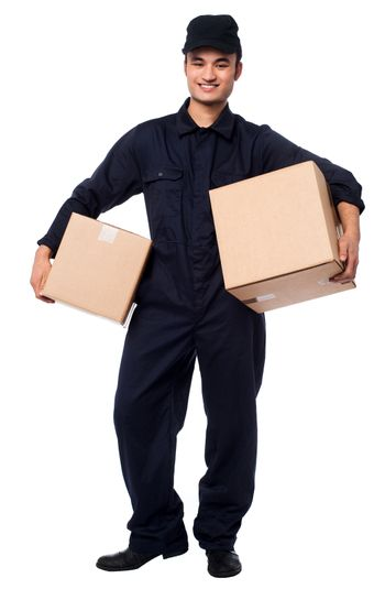 Young courier boy holding parcels