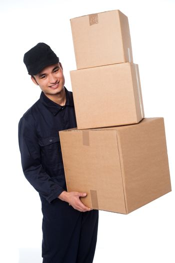 Young courier boy moving boxes
