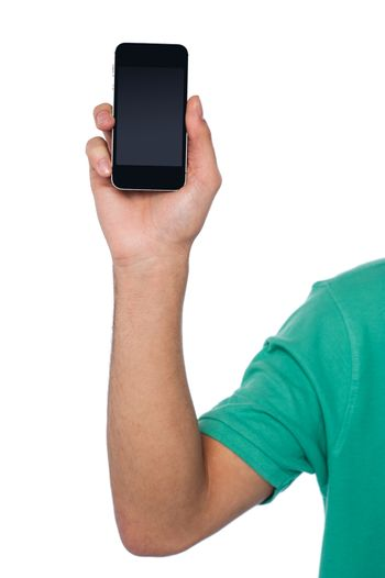 Cropped image of a guy displaying mobile handset