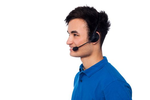 Young friendly guy wearing headset