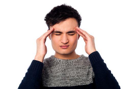 Young guy having headache