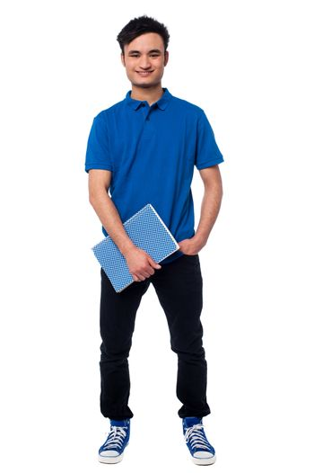 University student posing with notebook