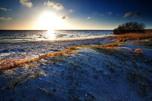 warm sunshine over beach by North sea