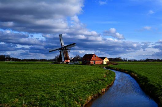 charming dutch windmill on green grasslands