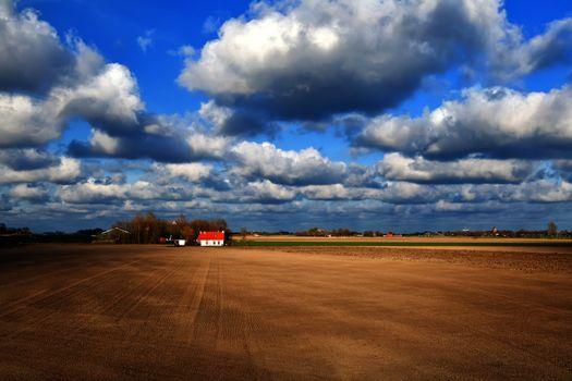 beautiful sky over dutch farmland