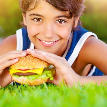 Cute boy eat hamburger