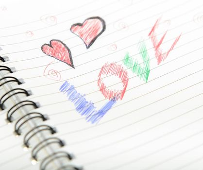 Pen drawing love doodle in a notebook