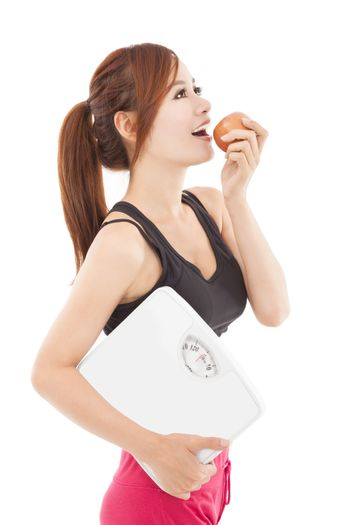 Beautiful young healthy woman eating apple