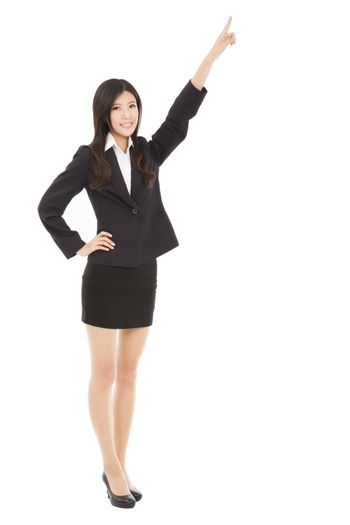 happy businesswoman pointing to copy space