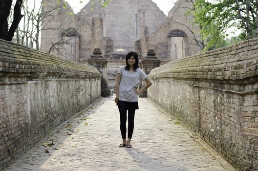 Asian woman at Wat Maheyong, Buddhist temple in Ayutthaya provin