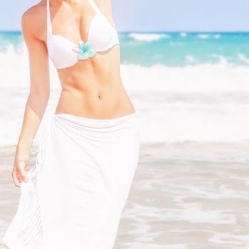 Slim female on the beach