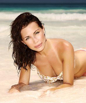 Sensual woman on seashore