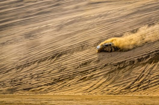 Off-road vehicle driving in the sand desert