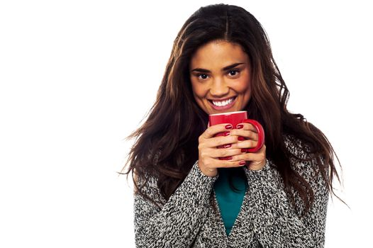 Relaxed mixed race woman having coffee