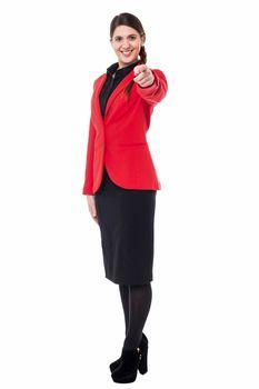 Elegant presentable businesswoman pointing