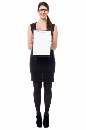 Business executive displaying blank clipboard