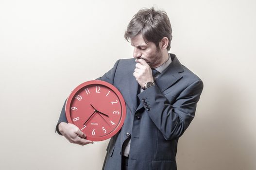 businessman with clock doubtful