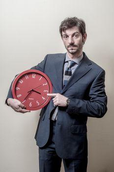 businessman pointing clock