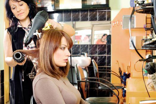dries hair in a hair salon
