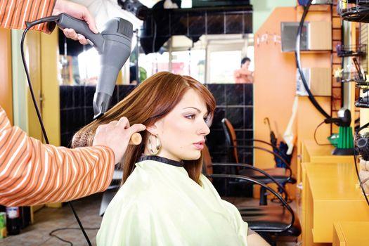 Hands of professional hairdresser