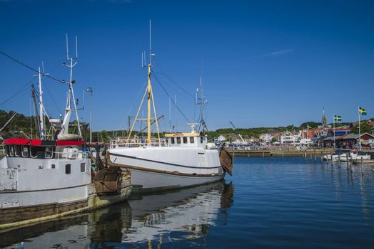 The fishing boats is moored to the docks in Grebbestad, Sweden.