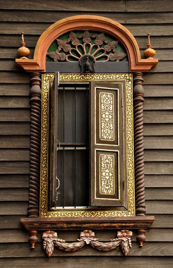 Window of the house is decorated with exquisite antiques.