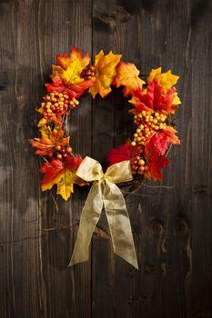 Autumn wreath hanging on a wooden door