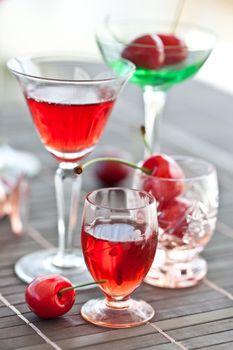 Various little glasses with cherry liquor