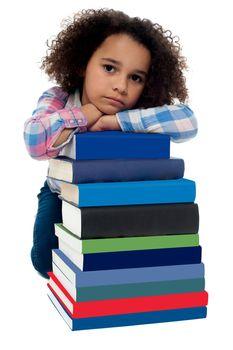 Sad little girl bored of reading