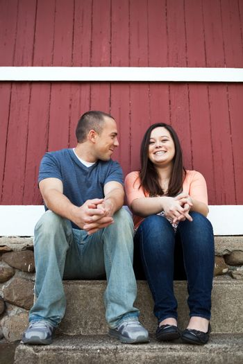 Young happy couple enjoying each others company outdoors.