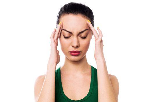 Asian woman having headache