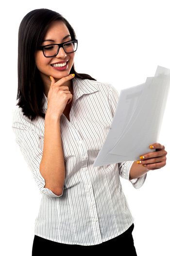 Female analyzing annual business reports